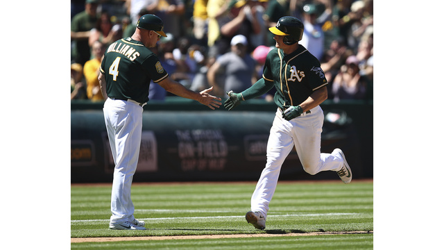 Chapman's homer in 8th lifts A's past Royals 3-2