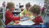Local students dissect worms after reading book
